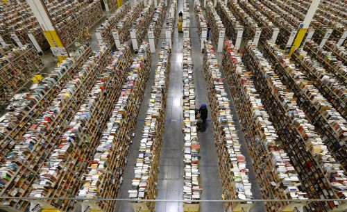 An Amazon employee stocks products on one of the many miles of aisles at a fulfillment center in Phoenix.