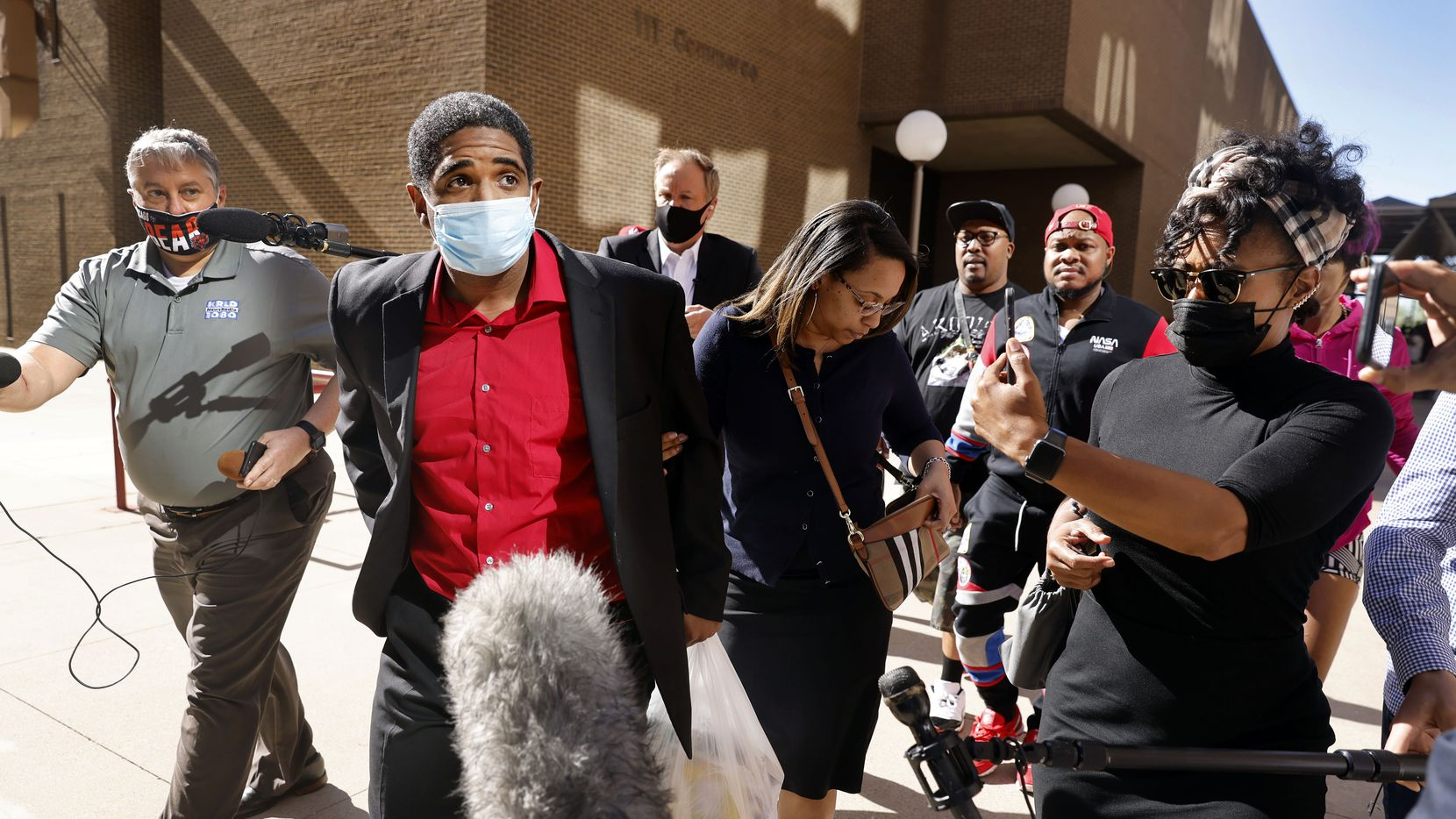 With his wife Eboni Samuel Riser by his side, former Dallas police officer Bryan Riser walks out of Lew Sterrett Justice Center after Dallas County Criminal Court Judge Audrey Moorehead ordered his release earlier in Dallas, Wednesday, April 7, 2021. Riser was originally charged with two counts of capital murder and was accused of ordering hits on two people. (Tom Fox/The Dallas Morning News)