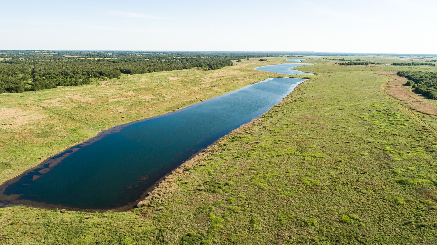 One of the 14 deep-water lakes in the Sandow Lakes Ranch site, which is up for sale for $250 million.