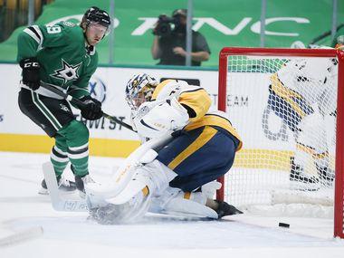 Dallas Stars forward Rhett Gardner (49) scores a goal against Nashville Predators goaltender Pekka Rinne (35) during the first period of an NHL hockey game in Dallas Sunday, March 21, 2021. (Brandon Wade/Special Contributor)