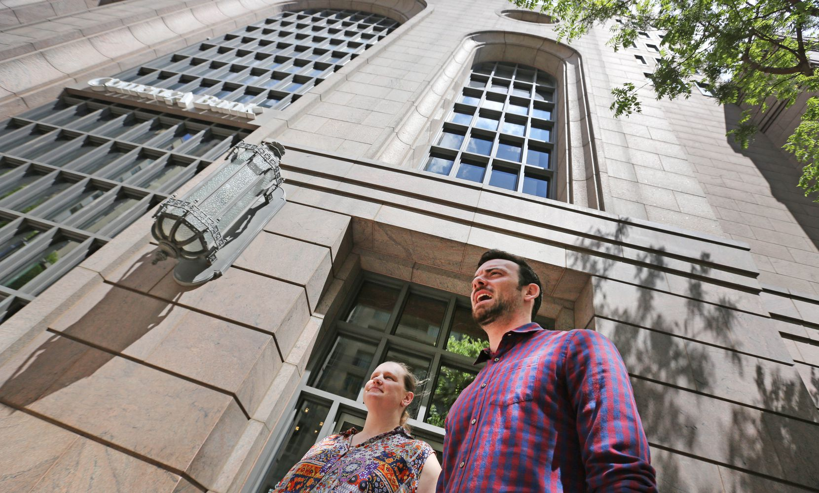 Dallas Morning News reporter Brendan Meyer and newspaper reader Xan Alexander try to get their bearings on street level as they look to enter the underground tunnels in downtown Dallas on Monday, April 23, 2018.