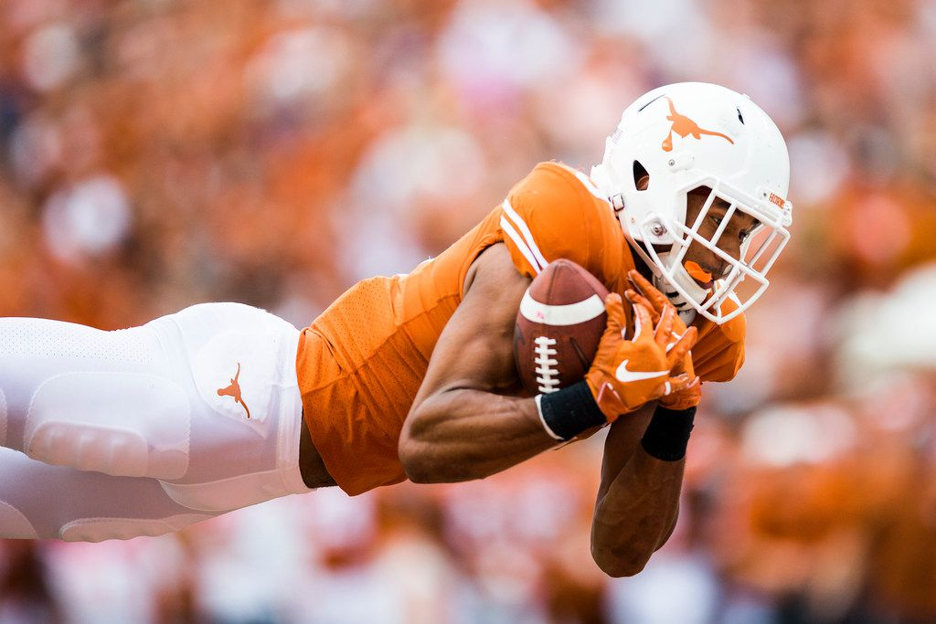 Texas Longhorns wide receiver Collin Johnson (9) catches a pass in the end zone for a touchdown during the third quarter of a college football game between TCU and the University of Texas on Saturday, September 22, 2018 at Darrell K Royal - Texas Memorial Stadium in Austin.