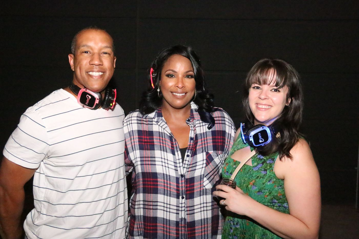 Pin Drop Disco on Saturday at Strauss Square in downtown Dallas featured DJ Spinderella (center), Sarah Jaffe and more. The event was a silent dance party, with attendees enjoying the music via headphones.