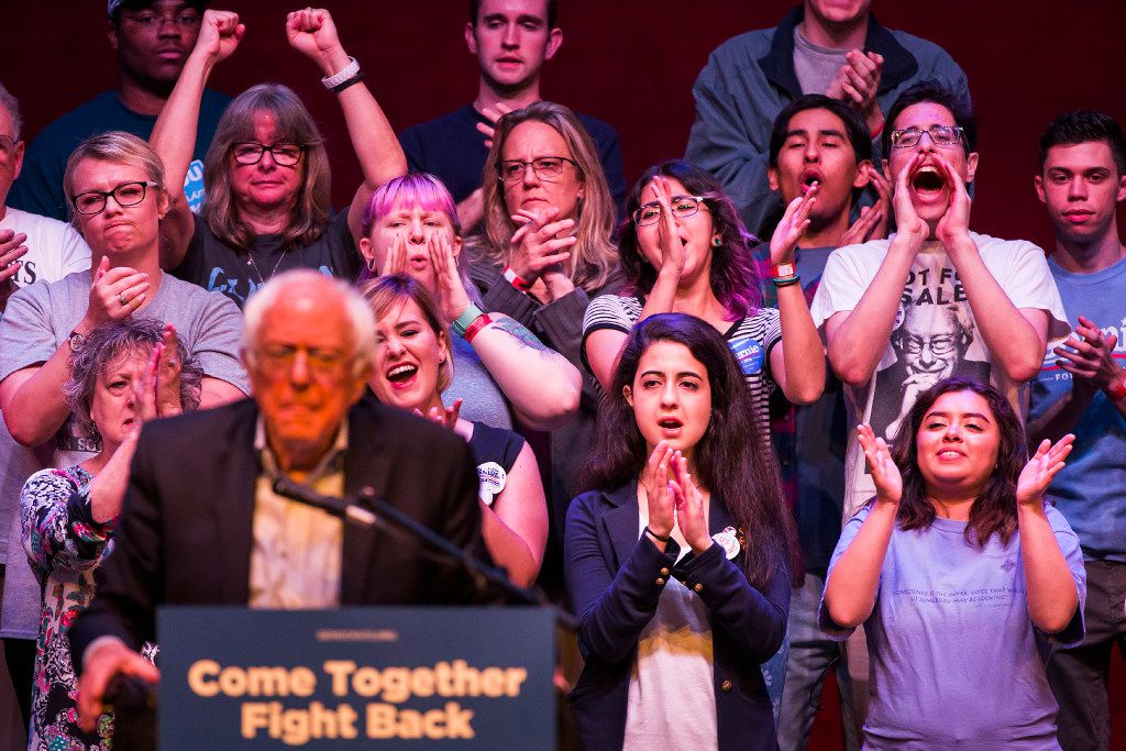 Supporters cheer as Bernie Sanders makes a case for a federal $15 minimum wage.
