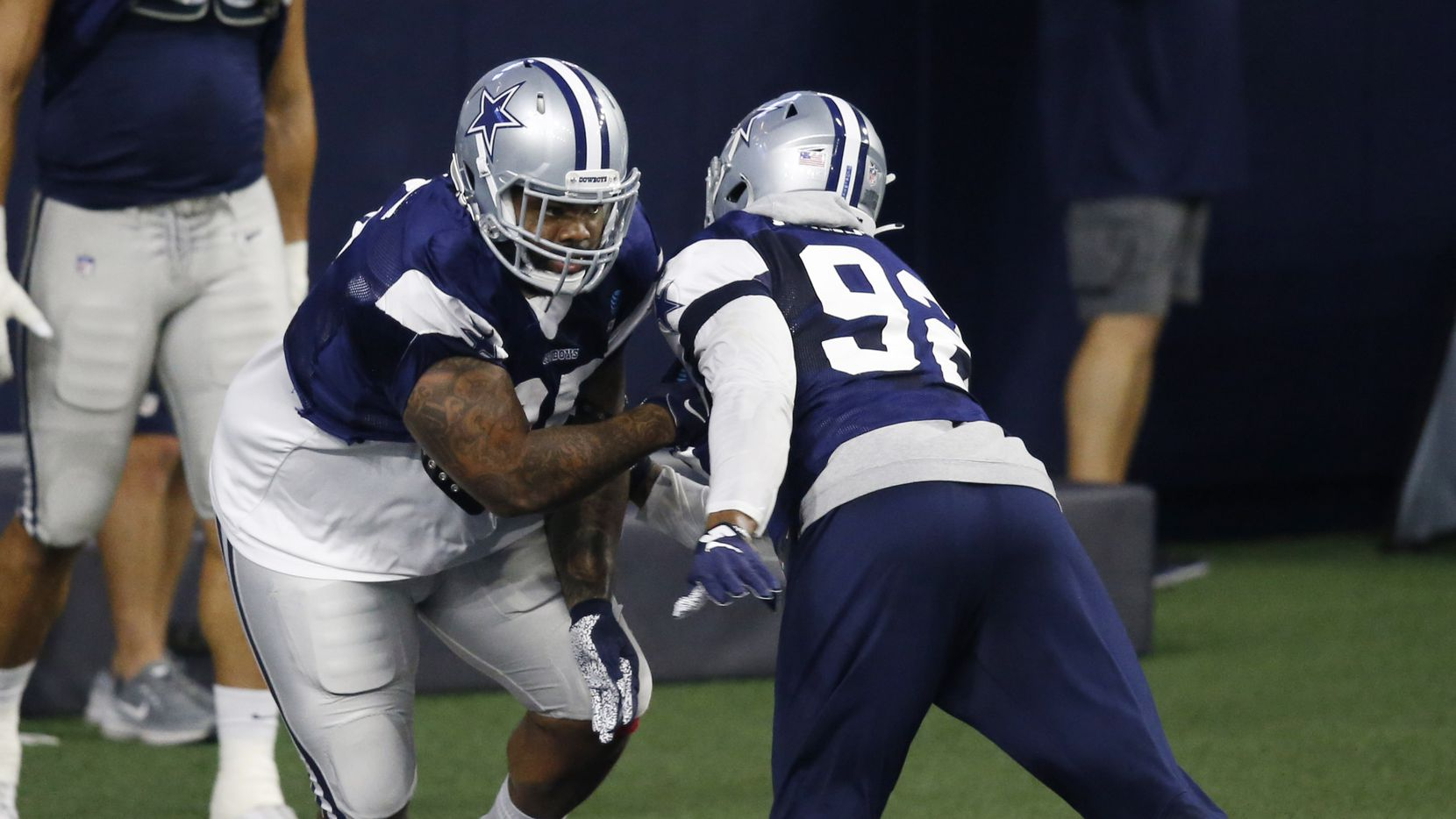 Dallas Cowboys defensive tackle Dontari Poe (95) runs through a drill with Dallas Cowboys defensive end Dorance Armstrong (92) in practice during training camp at the Dallas Cowboys headquarters at The Star in Frisco, Texas on Sunday, August 23, 2020.