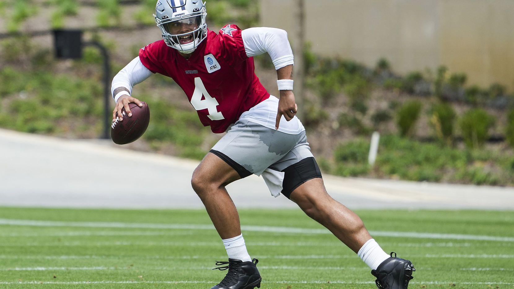 Dallas Cowboys quarterback Dak Prescott (4) runs a drill during a minicamp practice at The Star on Tuesday, June 8, 2021, in Frisco.