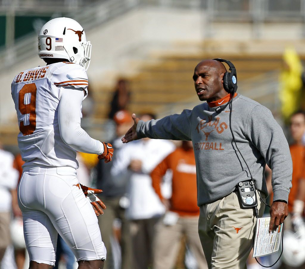 Texas head coach Charlie Strong, right, talks with cornerback Davante Davis (9) during the first half against Baylor at McLane Stadium on Saturday, Dec. 5, 2015, in Waco, Texas. Texas won 23-17. (Jae S. Lee/The Dallas Morning News)