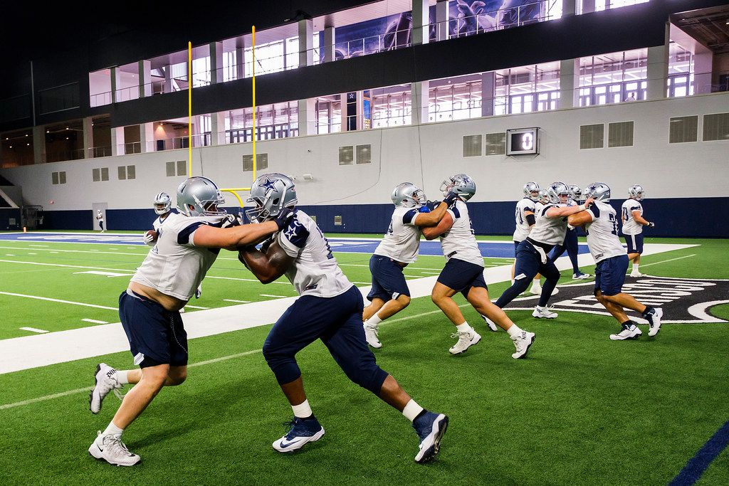FILE - Dallas Cowboys offensive tackle Tyron Smith (center) works against tackle Mitch Hyatt (left) during a team OTA practice at The Star on Wednesday, June 5, 2019, in Frisco. (Smiley N. Pool/The Dallas Morning News)
