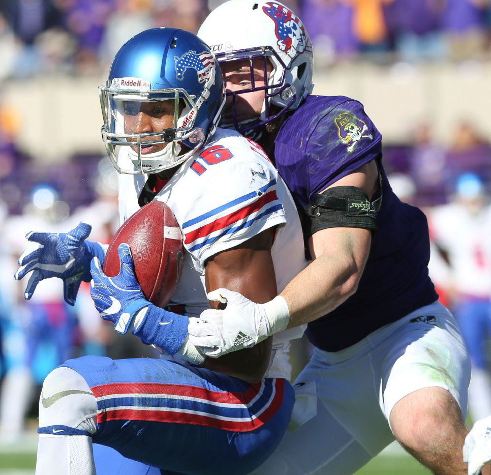 East Carolina's Cam White tackles SMU's Courtland Sutton during the first half of an NCAA college football game, Saturday, Nov. 12, 2016, at Dowdy-Ficklen Stadium in Greenville, N.C.  ( Rhett Butler/The Daily Reflector via AP)
