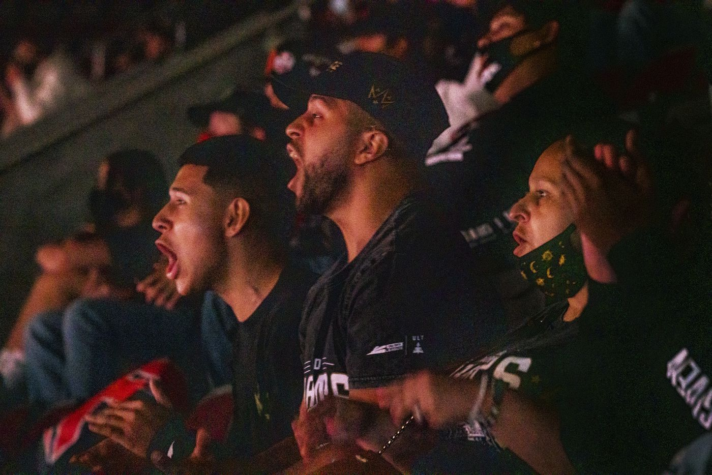 """From left, Anthony """"Shotzzy"""" Cuevas-Castro brothers Steven Quevedo, Gabriel Castro, and his mother Christina Hernandez cheer as they watch their Shotzzy compete during the winners final of the Call of Duty league playoffs at the Galen Center on Saturday, August 21, 2021 in Los Angeles, California. The Empire lost to FaZe 0 - 3 in their first match of the day but are still in contention to play in the finals through the elimination finals. (Justin L. Stewart/Special Contributor)"""