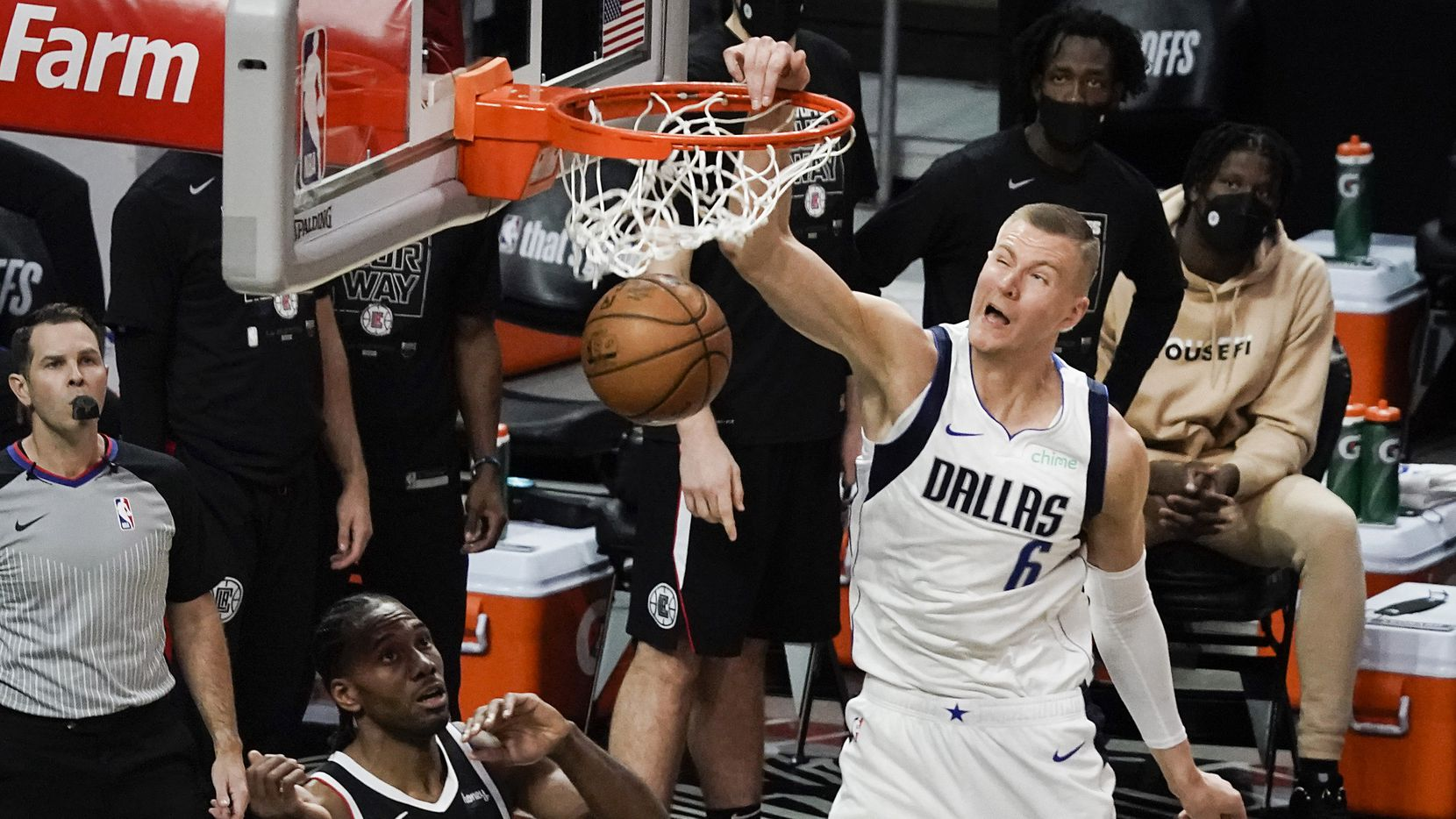 Dallas Mavericks center Kristaps Porzingis (6) dunks the ball past LA Clippers forward Kawhi Leonard (2) during the final minute of second half of an NBA playoff basketball game at Staples Center on Saturday, May 22, 2021, in Los Angeles. The Mavericks won the game 113-103.