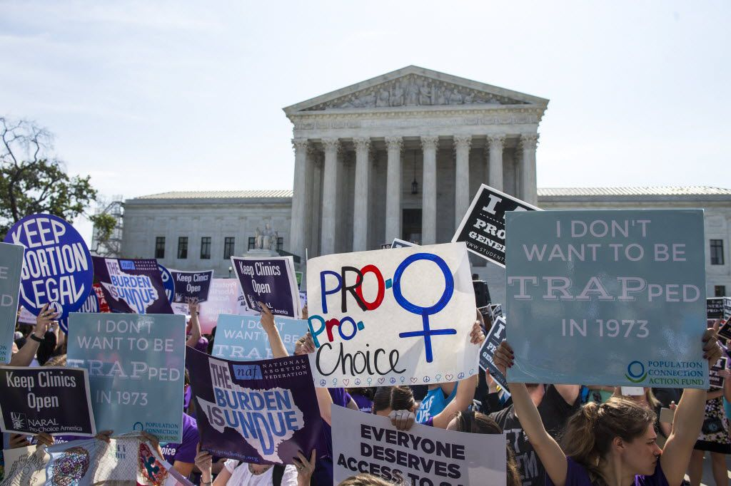 Demonstrators rallied outside the U.S. Supreme Court before it struck down a law on abortion clinic restrictions last month.