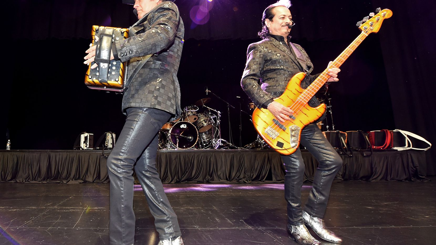 Recording artists Jorge Hernandez (L) and Hernan Hernandez of the band Los Tigres del Norte perform at the Nevada Democratic Party's election results watch party at the Aria Resort & Casino on November 8, 2016, in Las Vegas.