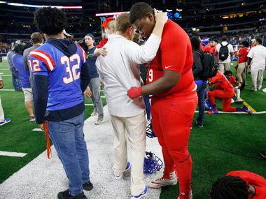 Duncanville's Jordan Phillips (79) cries on the sidelines after being beat by Galena Park North Shore in  the Class 6A Division I football state championship game at AT&T Stadium in Arlington, Texas on Dec 22, 2018. Galena won 41-36.  (Nathan Hunsinger/The Dallas Morning News)