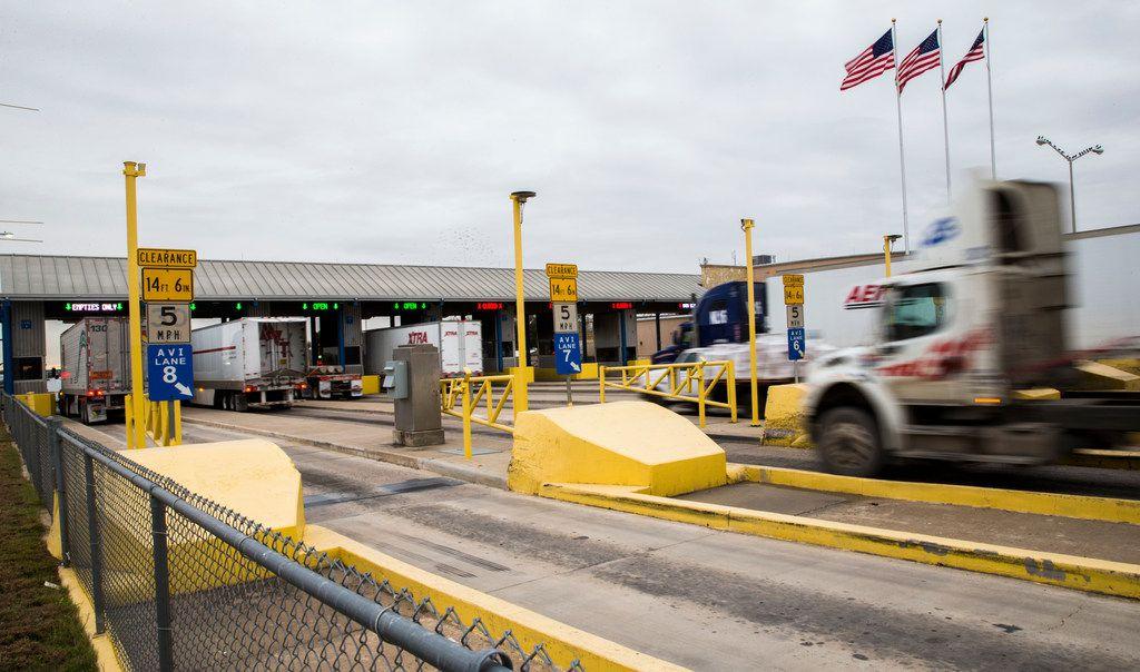 Trucks pass from the U.S. into Mexico across the World Trade Bridge in Laredo.