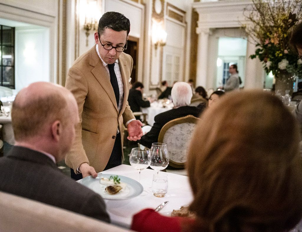 General Manager Victor Rojas serves a dish at the French Room.