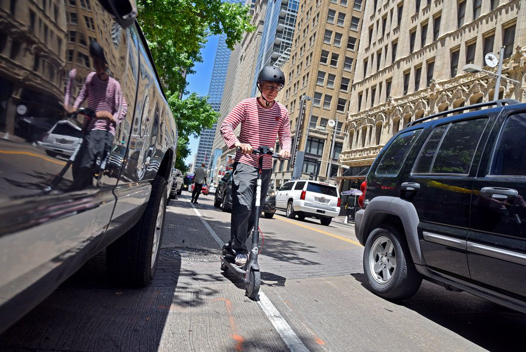 Matthew Bashover, 60, test rides a Bird electric scooter along Main Street as the company debuted it's fleet of electric scooters in downtown Dallas on  June 29.