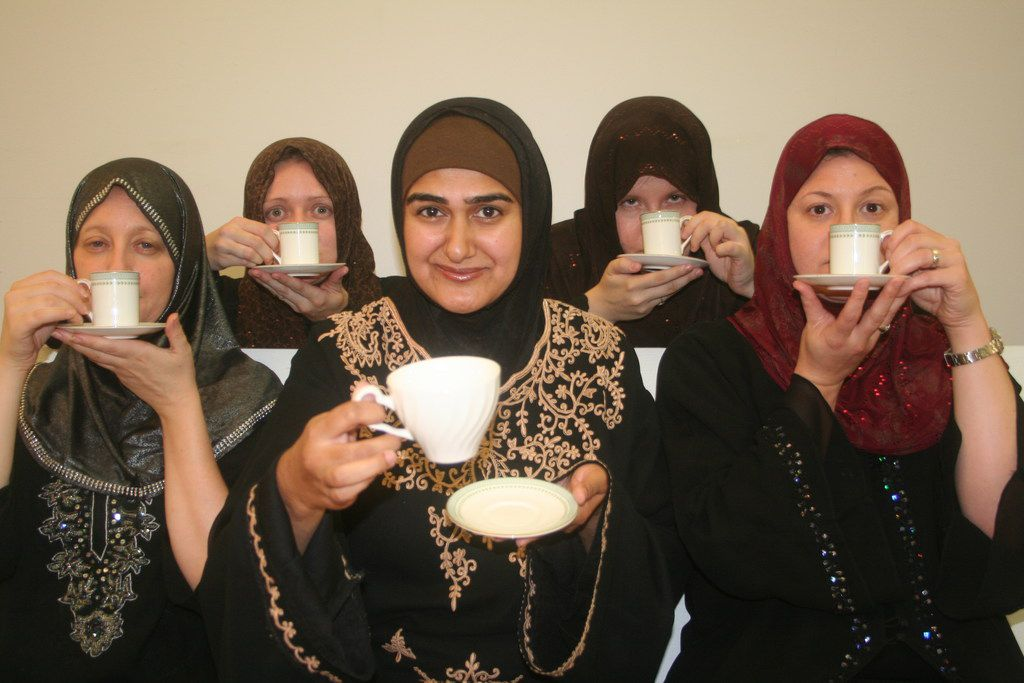 Rohina Malik (center) portrays five tea-sipping Muslim women from different backgrounds in her one-woman show Unveiled. She has been performed all over the world.
