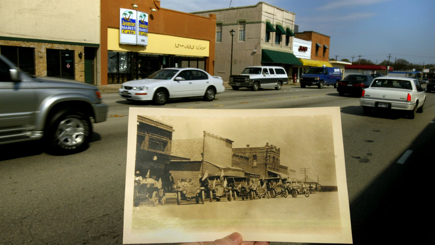 A copy of an early 1900s photograph from the Richardson Public Library showing the north side of Main Street in downtown Richardson, is contrasted with traffic on the street on March 11, 2004.