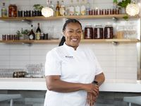 Chef-Owner Tiffany Derry poses for a photo at her restaurant, Roots Southern Kitchen, in Farmers Branch, Wednesday, June 9, 2021. (Brandon Wade/Special Contributor)