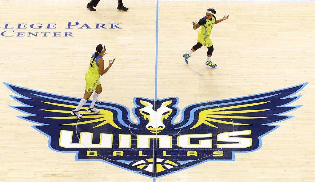 Dallas Wings players cross midcourt during their first home opener against the San Antonio Stars at College Park Center in Arlington, Saturday, May 21, 2016.