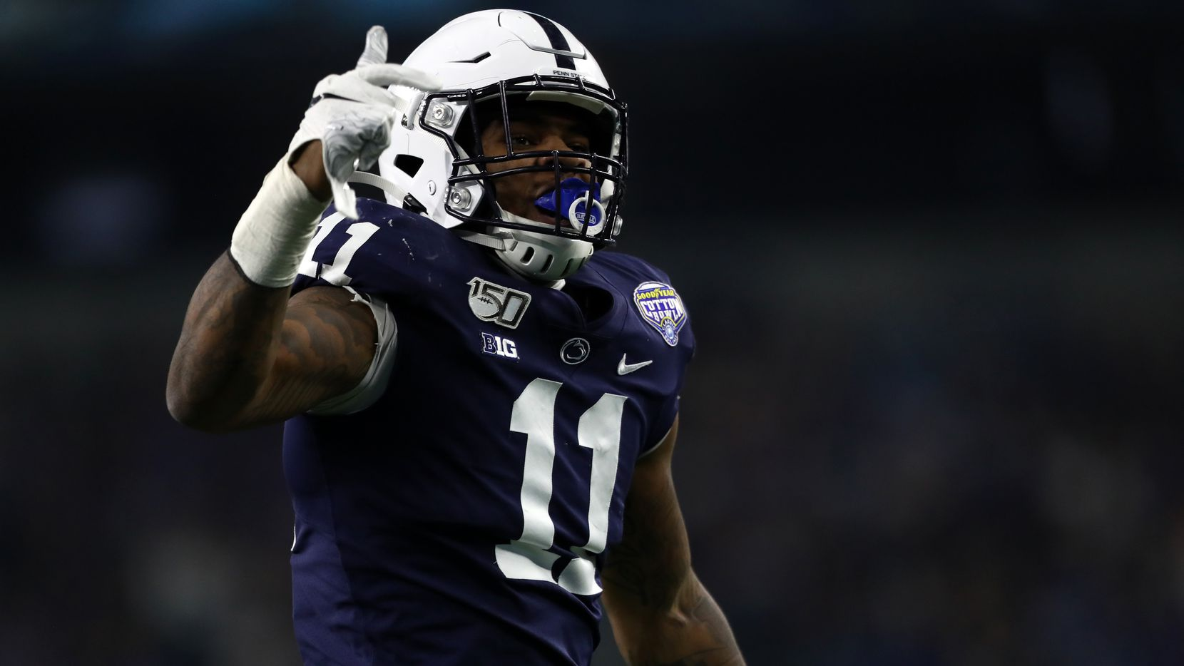 In this photo from 2019, Penn State linebacker Micah Parsons (11) reacts after sacking Memphis quarterback Brady White (3) in the first half of the Cotton Bowl Classic at AT&T Stadium in Arlington. (Ronald Martinez/Getty Images/TNS)