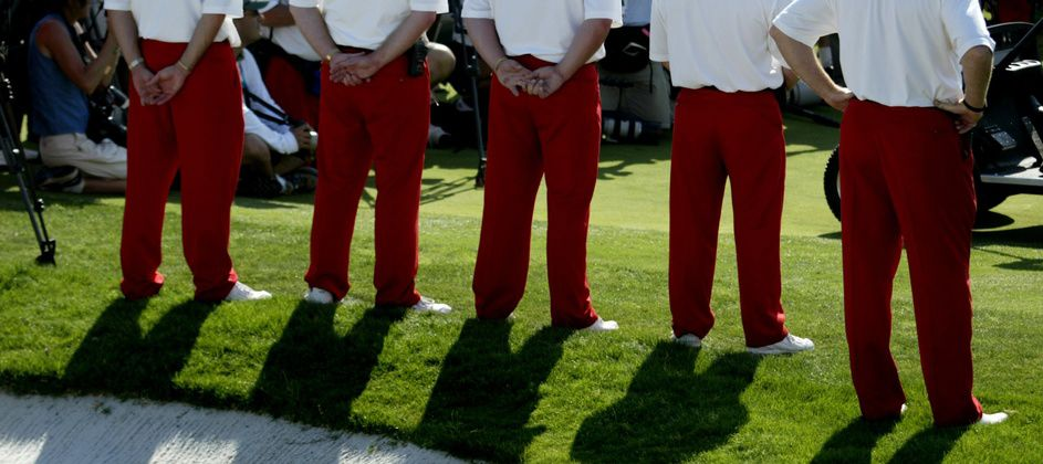 Tournament volunteers clad in the signature red slacks identifying them as Salesmanship Club members stand at attention during the 2006 Byron Nelson Classic trophy presentation. The first female members in the club's history will work the 2018 tournament.