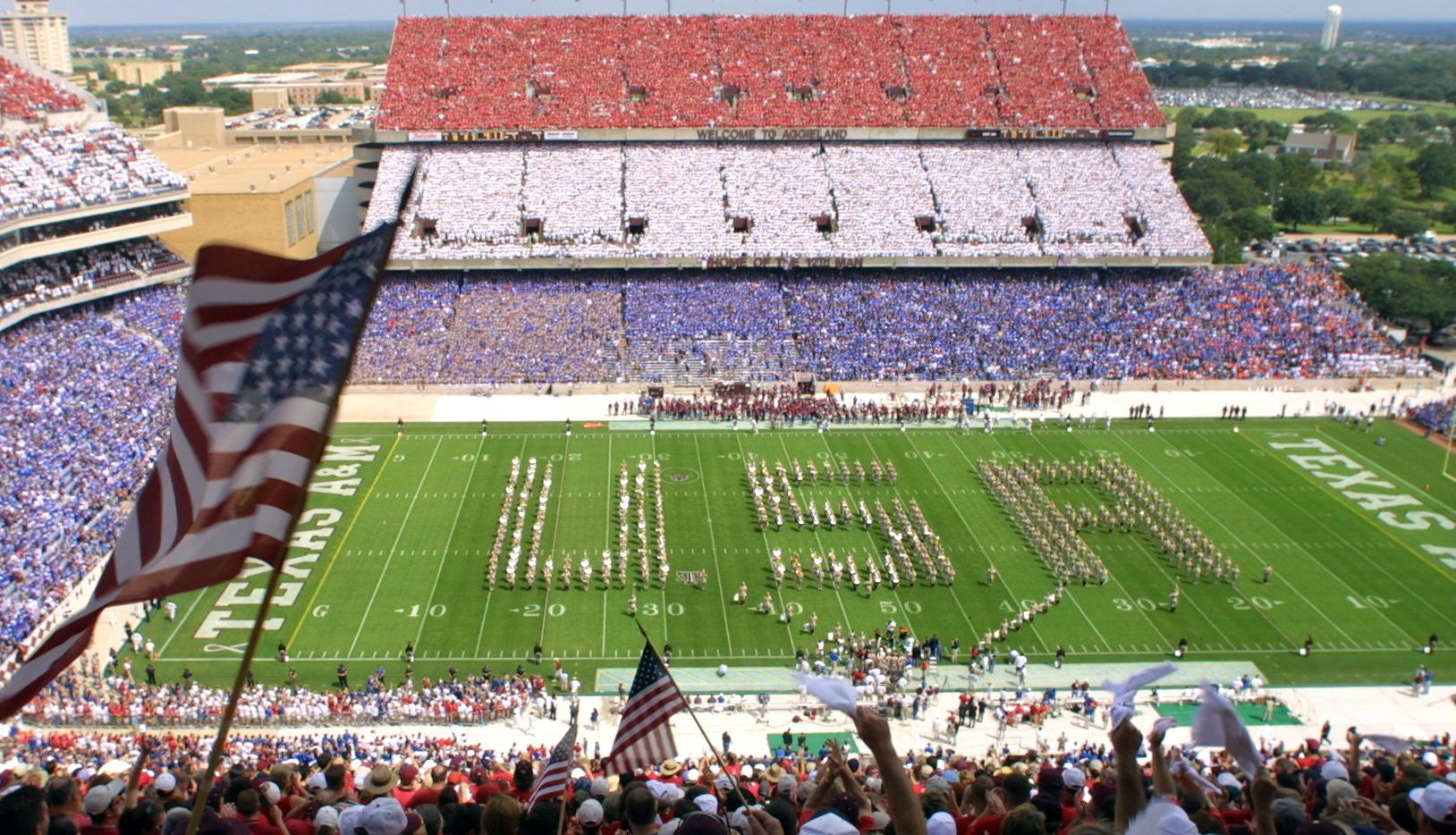 The Fightin' Texas Aggie Marching Band forms a 'USA' on Kyle Field as fans on the three different levels wore red, white, and blue t-shirts in a patriotic tribute during the halftime show in the Aggies win over OSU, September 22, 2001.  T-shirts were sold on campus before the game to raise money for the relief efforts. (Erich Schlegel/The Dallas Morning)