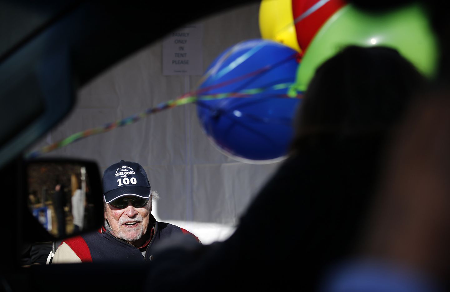 Eddie Robinson, the oldest living former MLB player, visits with friends who delivery an early 100th birthday wish with balloons. He will turn 100 on December 15th. To share his birthday with friends, his family orchestrated a drive-by celebration outside his Fort Worth home, Saturday, December 12, 2020. His 65 year career started by playing for the Cleveland Indians and serving in World War II. Later he went on to play for several other teams before presiding over three winning seasons as the Texas Rangers general manager. He is still in great physical health as he waves to passersby, including former teammates, GM Tom Grieve and U.S. congressman and neighbor Marc Veasey. (Tom Fox/The Dallas Morning News)