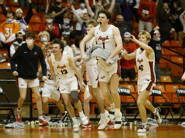 Argyle's Blake Petter (13) Jacob Dye (1) and Rand Nash (40) celebrate their victory over Oak Cliff Faith Family during a boys basketball Class 4A state semifinal in Fort Worth, Texas on March 9, 2021.