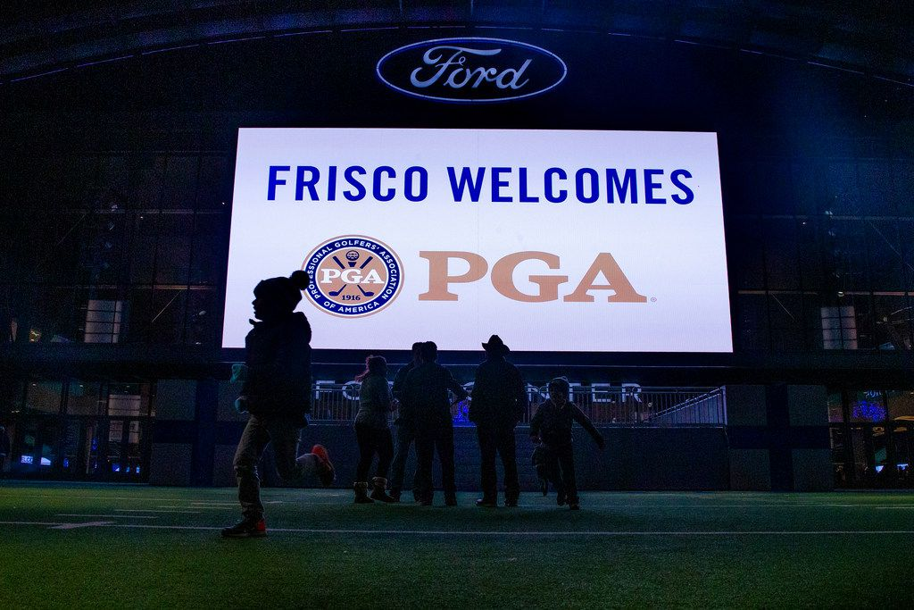 Visitors play on the field as a message welcoming the PGA of America to Frisco, Texas is seen at the Ford Center at the Dallas Cowboys headquarters at The Star in Frisco on Tuesday, December 4, 2018. The Frisco city council approved a plan for the PGA of America to move its headquarters to Frisco. The PGA is joining the Dallas Cowboys, FC Dallas, and others in making Frisco, Texas their home. (Shaban Athuman/The Dallas Morning News)