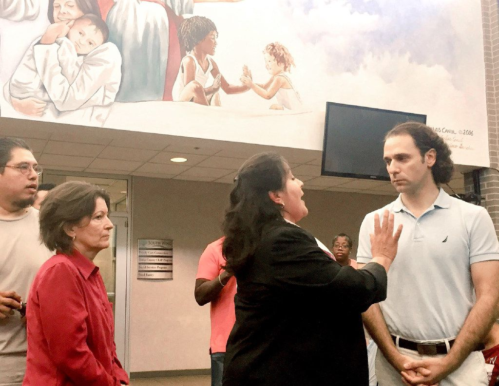 Landlord Khraish Khraish (right) of HMK Ltd. had a tense run-in with West Dallas tenants and community leaders Saturday over plans for mass evictions. Mayor Pro Tem Monica Alonzo, who represents West Dallas, tried to calm people.