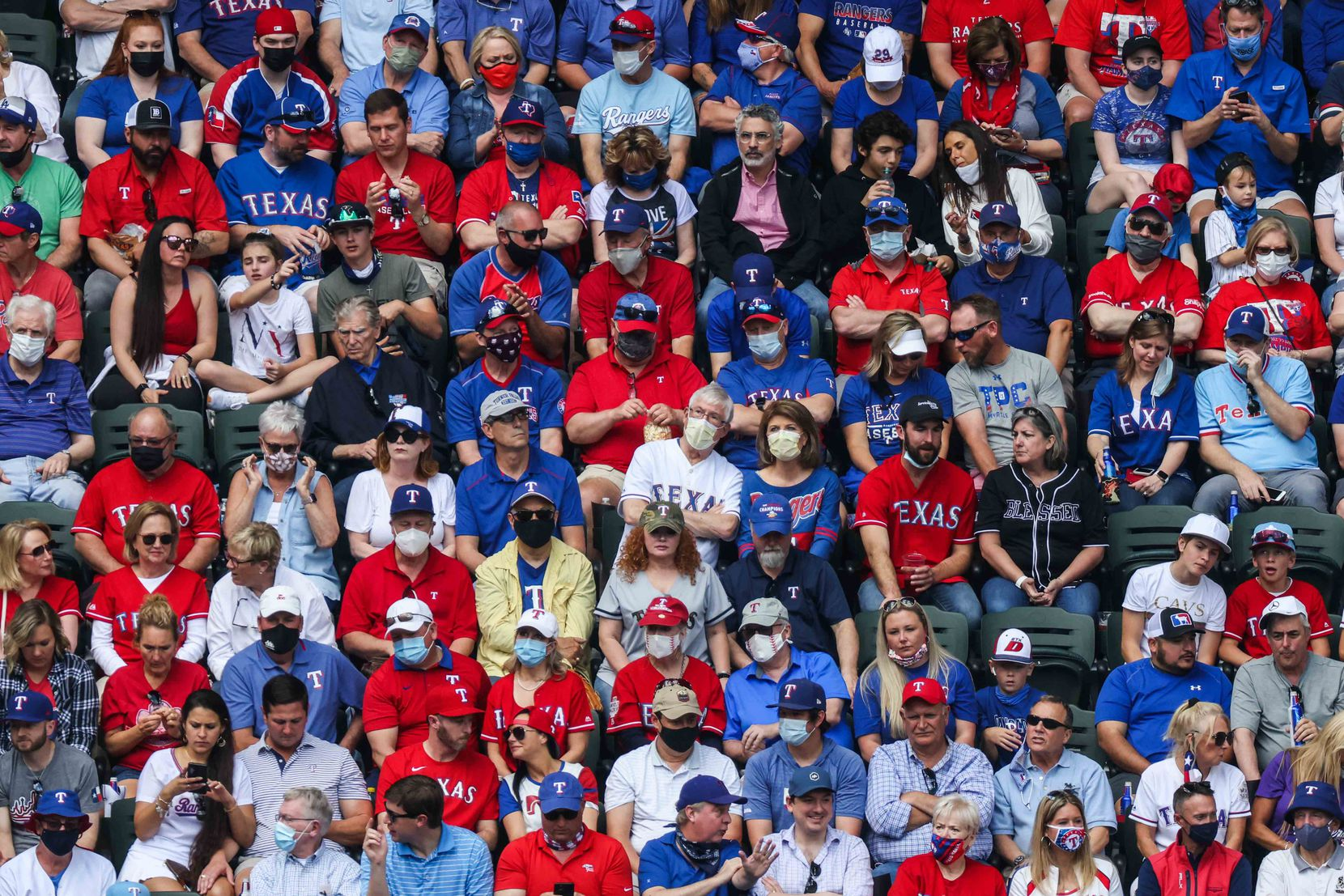 Fans watch the game between Texas Rangers and Toronto Blue Jays at the Globe Life Field during opening day in Arlington, Texas on Monday, April 5, 2021. (Lola Gomez/The Dallas Morning News)