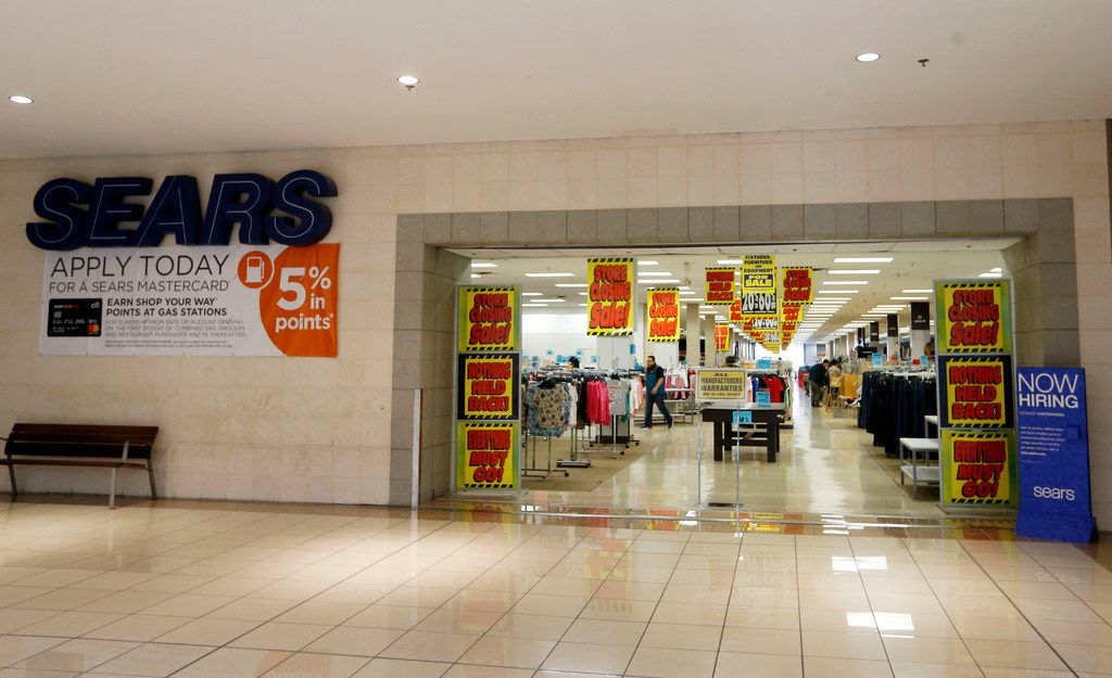 """The Sears has """"store closing sale"""" signs posted at Collin Creek Mall in Plano, Texas on Wednesday, February 13, 2019. 2018 was Collin Creek's final Christmas. The mall's new owner plans to redevelop the property into a mixed-use development. (Vernon Bryant/The Dallas Morning News)"""