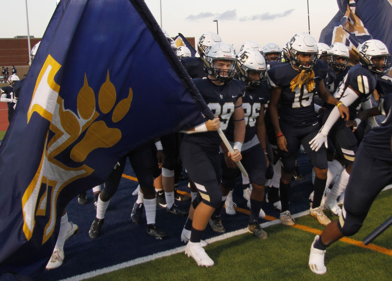Members of the Little Elm Lobos prepare to run onto the field prior to the opening kickoff of their game against Plano West. The two teams played their non-district 6A football game at Lobo Stadium in Little Elm on October 9, 2020. (Steve Hamm/ Special Contributor)