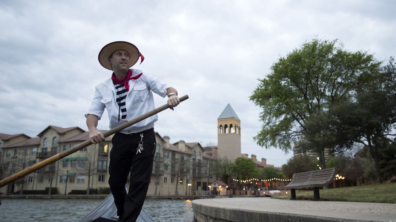 Greg Mohr, chief gondolier for Gondola Adventures, rows his gondola on Las Colinas' Lake Carolyn in March, 2013 in Irving, Texas.
