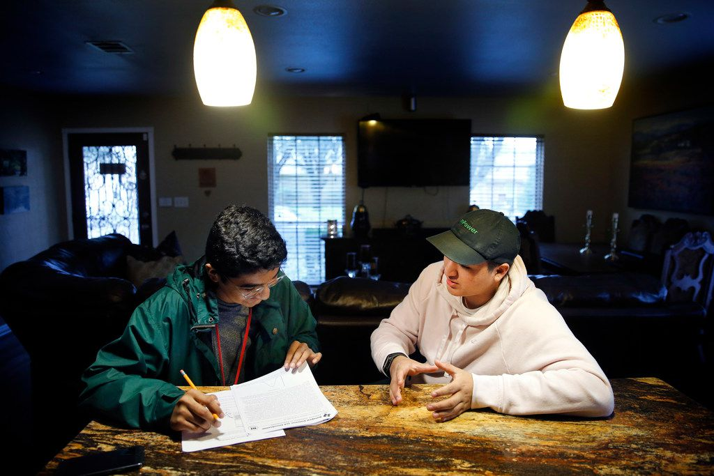 David Mojica (left), a freshman at Duncanville High School, receives some help on his biology homework from his older brother Erick Mojica at their Dallas home.  Mojica, a freshman at Duncanville High School,  could soon need a bone marrow transplant from a donor. For Latino patients clinging to life, like David, there's a desperate need to find bone marrow donors of Hispanic origin.