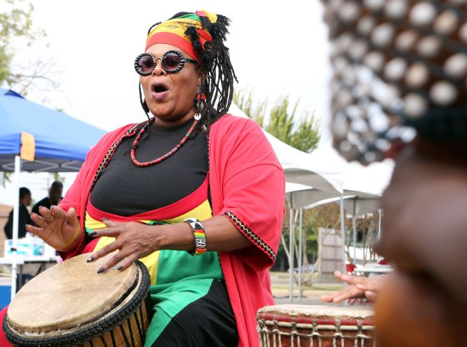 Afiah Bey performs in a drum circle at the 39th annual Harambee Dallas Festival at the Martin Luther King Jr. Community Center.