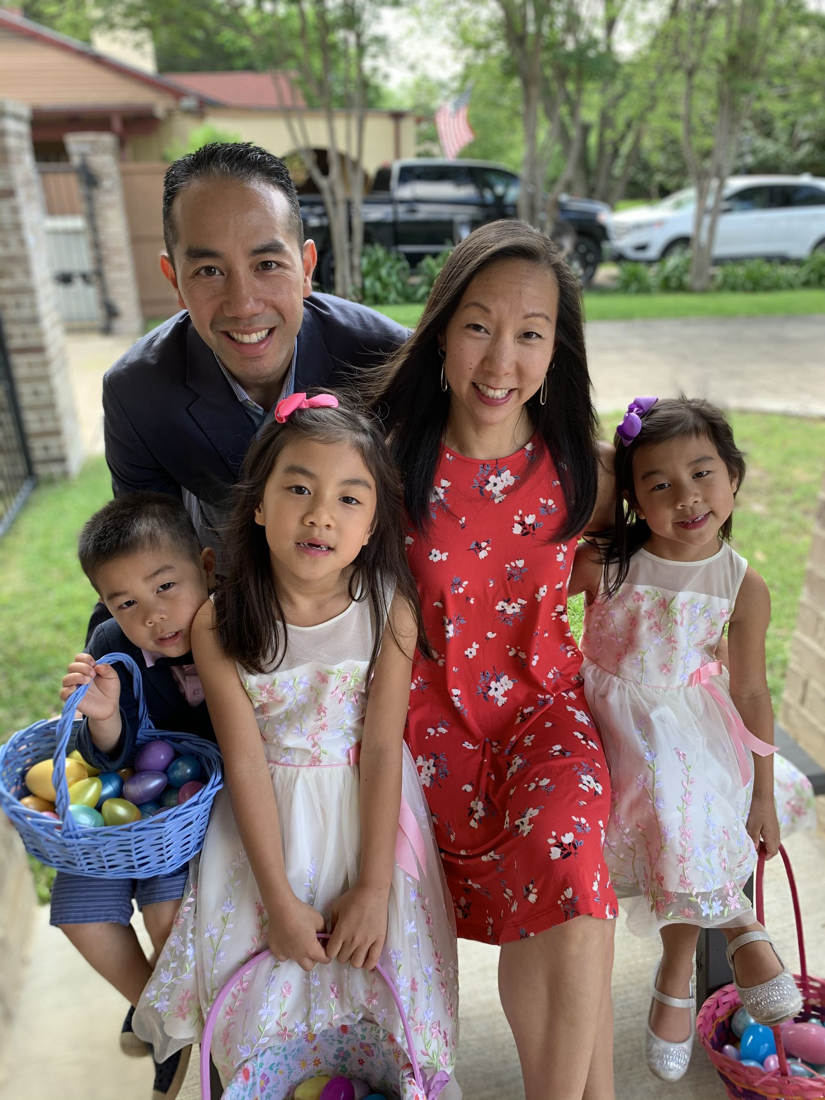 Lisa and Jimmy Tran with their children Lila (center), 8, Livia (right), 6, and Jordan, 4, at their home in Dallas on April 12, 2020.