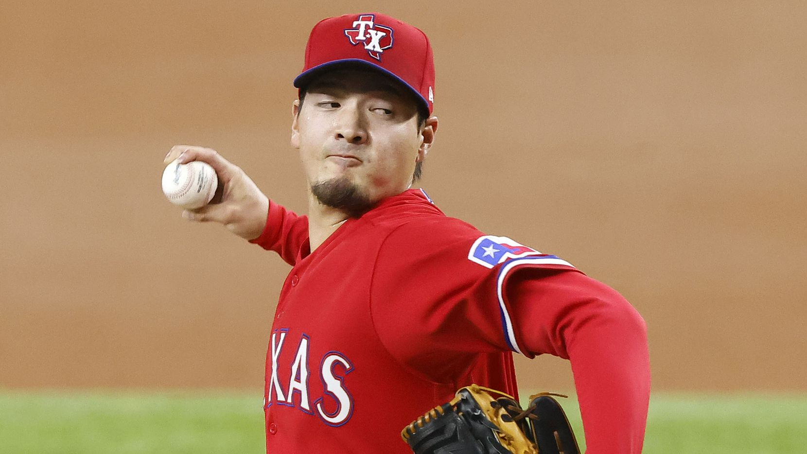 Texas Rangers starting pitcher Kohei Arihara (35) throws against the Boston Red Sox during the first inning at Globe Life Field in Arlington, Texas, Friday, April 30, 2021.