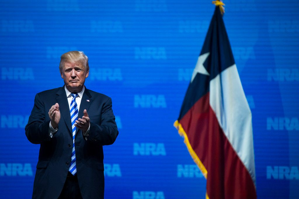 President Donald Trump applauds the crowd after addressing the NRA Annual Meeting at the Kay Bailey Hutchison Convention Center in Dallas, on Friday, May 4, 2018. (Smiley N. Pool/Dallas Morning News/TNS)