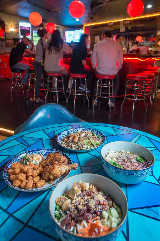 You could get pizza at Cosmo's, a dive bar in Dallas. But opt for a Vietnamese dish instead and you won't be disappointed.