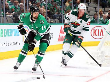 Dallas Stars left wing Jamie Benn (14) is pursued by Minnesota Wild defenseman Ryan Suter (20) in the first period during an NHL hockey game Friday, Feb. 7, 2020 in Dallas. (AP Photo/Richard W. Rodriguez)
