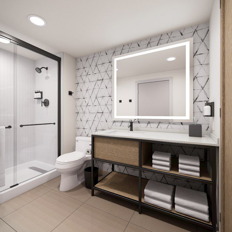 Backlit mirrors are a draw in the bathrooms of Atwell Suites rooms.