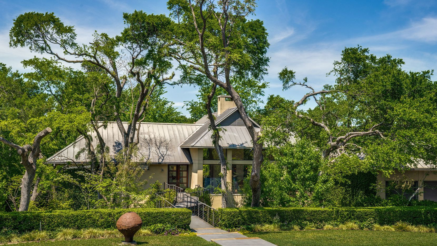 The property at 10045 Surrey Oaks Circle in Preston Hollow is offered for $3,750,000.