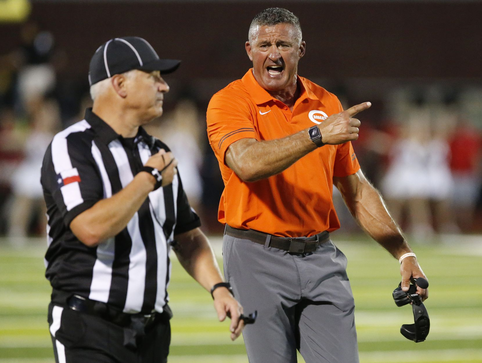 Celina High School head coach Bill Elliott questions why a touchdown was called back for a penalty during the first half as Melissa High School hosted Celina High School at Cardinal Field in Melissa on Friday night, August 27, 2021. (Stewart F. House/Special Contributor)