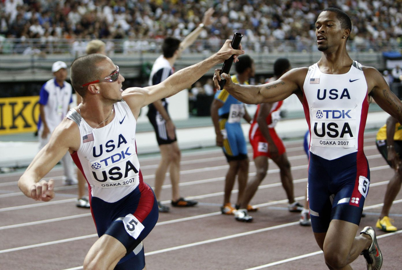 From 2007: United States' Jeremy Wariner, left, takes the baton from Darold Williamson as the US Men's 4x400m Relay wins the gold medal during the World Athletics Championships Sunday, Sept. 2, 2007, in Osaka, Japan.