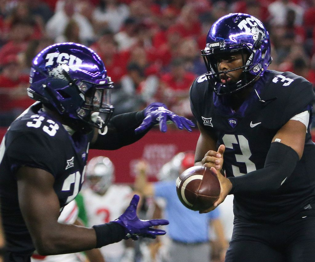 TCU Horned Frogs quarterback Shawn Robinson (3) hands off to running back Sewo Olonilua (33) during the AdvoCare Showdown between the Ohio State Buckeyes and the Texas Christian University Horned Frogs on Saturday, Sept. 15, 2018 at AT&T Stadium in Arlington, Texas. (Ryan Michalesko/The Dallas Morning News)