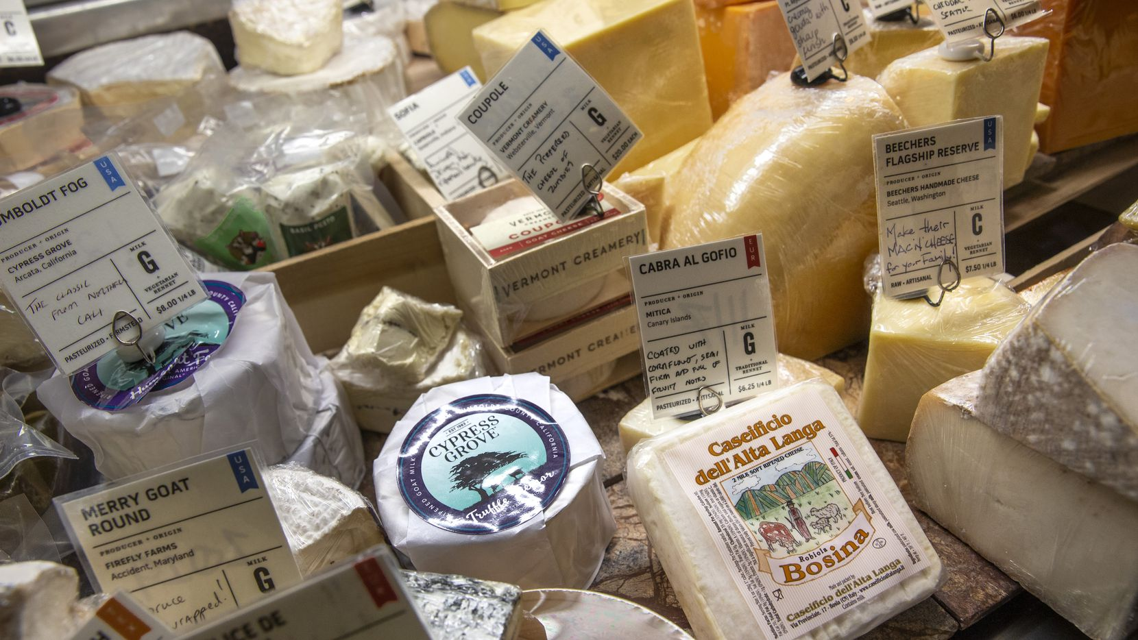 Caseificio Dell'Alta Langa Robiola Bosina (right) is among the European cheeses that will increase in price at Scardello Artisan Cheese in Dallas due to new tariffs.