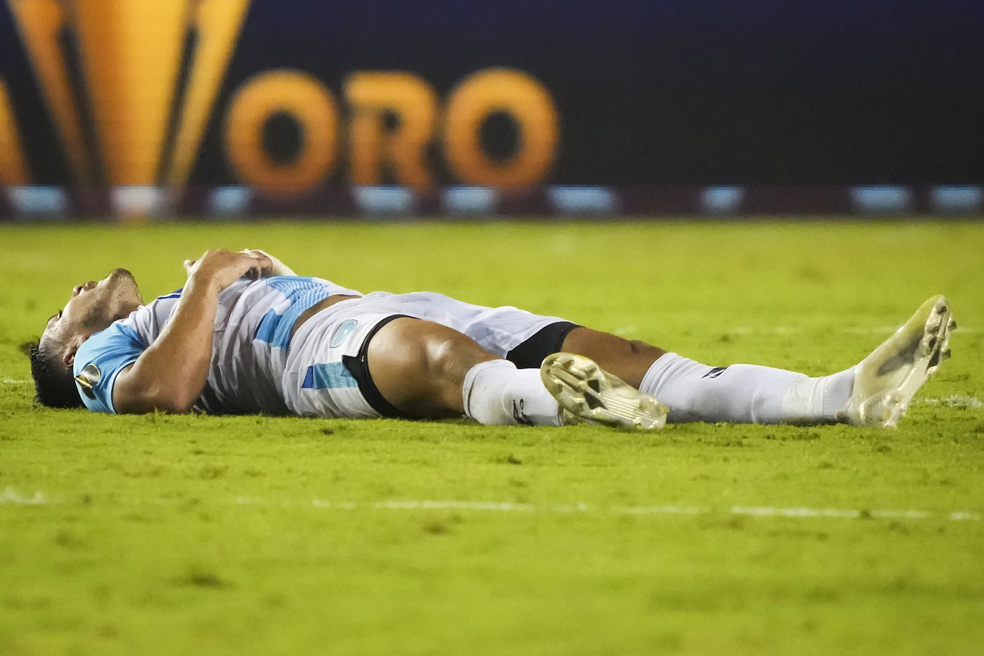 Guatemala forward Darwin Lom collapses on the turf after a collision during the second half of a CONCACAF Gold Cup Group A soccer match against Mexico at the Cotton Bowl on Wednesday, July 14, 2021, in Dallas.